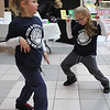 Jordan Bartlett left, and Makenzie Petillo took advantage of the dancing provided inbetween races at the Diaper Derby at the Square One Mall on February 25. Photo by Owen O'Rourke