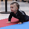 Devin Dominique of Revere rushes to a first place finish in the 3rd heat of the Diaper Derby at the Square One Mall in Saugus on February 25. Photo by Owen O'Rourke