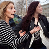 Karen Digrazia, and her daughter Bella, 16, discuss the recent fight and the subsequent suspensions of students who watched and recorded it, at Lynn English High School on Monday, February 27. Item Photo / Angela Owens.