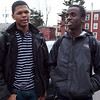 Alex Bonitto, 17, and Peter Matu, 16, discuss the recent fight and the subsequent suspensions of students who watched and recorded it, at Lynn English High School on Monday, February 27. Item Photo / Angela Owens.