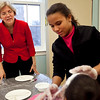 Elizabeth Warren looks on as Scarlett Hernandez puts a mask on another girl's face at Girls Inc. in Lynn on Monday, February 27. Item Photo / Angela Owens.