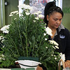 Nilda Gonzalez building a flower arrangment at Salvy the Florist on Western Ave. in Lynn. Photo by Owen O'Rourke