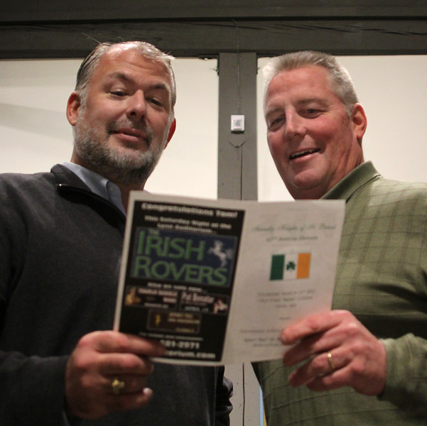 Bill McDonald, left, and Mike Reddy,right, the Irishmn of the Year, plan this year's event at the Lynn Museum Thursday evening. Photo by Owen O'Rourke
