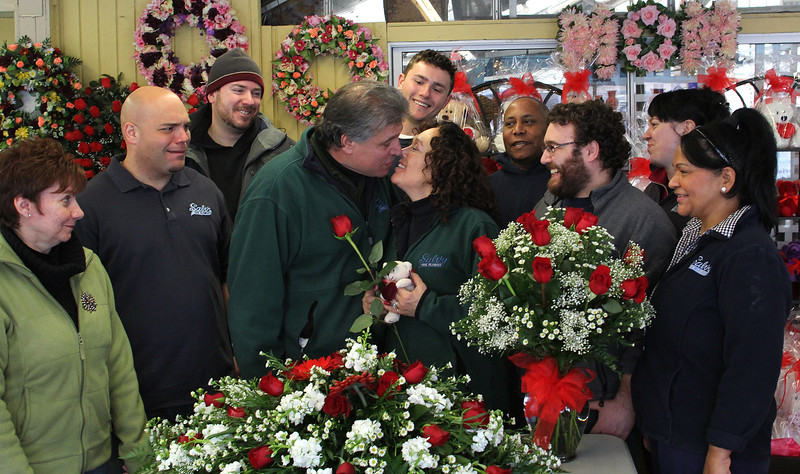 Salvy Migliaccio and his wife of 34 years Anne, middle, surrounded by from left to right by: Pattie Lagorio, Salvy Rocco Migliaccio, Dave Febonio, Anthony Bicchieri, David Mercedes, Anthony Migliaccio, Candy McKanas, and Nilda Gonzalez in their flower shop on Western Ave. in Lynn. Photo by Owen O'Rourke