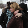 Nextdoor neighbor Felicia Puopolo is comforted by friends. She knew the fire victim at 79 Resevoir Ave. in Revere well. He was a great guy. Photo by Owen O'Rourke