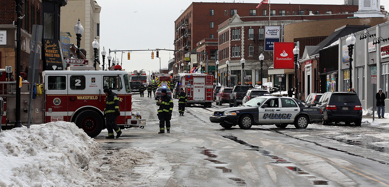 A section of Broadway in Revere near City Hall was closed to traffic while fire fighters battled a 3 alarm blaze today on Resevoir Ave. that killed an elderly man. Photo by Owen O'Rourke
