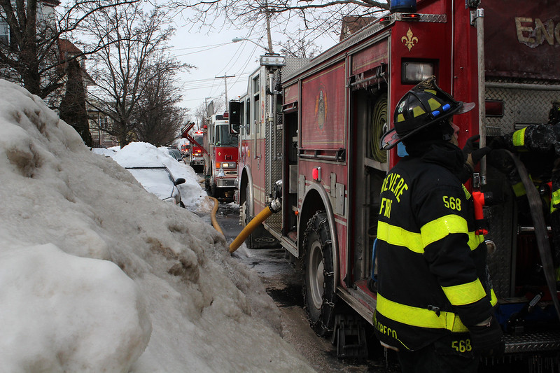 Fire trucks lined Resevoir Ave. in Revere to fight the 3 alarm blaze that killed one man today. Photo by Owen O'Rourke