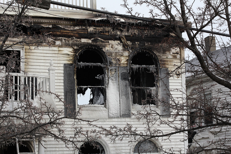Right front corner second floor of the house at 79 Resevoir Ave. in Revere, the scene of a 3 alarm fire that started at 5:30 today and claimed the life of Dennis Toomey. Everyone living on the top floor escaped safely. Photo by Owen O'Rourke