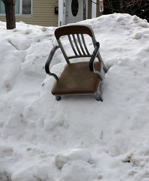 It's not hard to find a chair these days, although unlike this one next to Revere City Hall,  they are usually on the pavement.