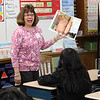 Sylvia George, a retired Ingalls School teacher, reads to students in a 4th grade class at Ingalls School  during Community Reading Day on February 7. Photo by Owen O'Rourke