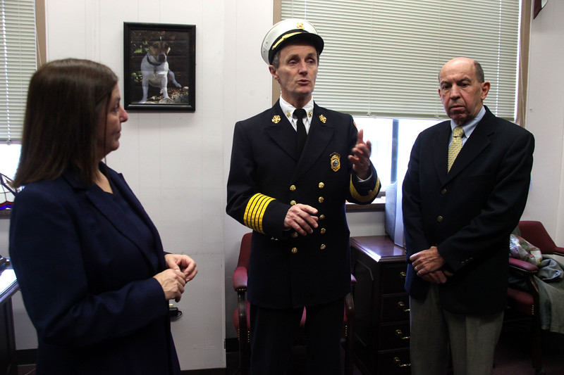 Fire Chief James Carrite with Mayor Edward Clancy, right,a nd Mayor Elect Judith Flanagan Kennedy during his swearing in ceremony at Lynn's City Clerk office Thursday December 31, 2009. Item Photo/ Reba M. Saldanha