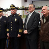 Police Chief Kevin Coppinger, second from left, poses with Woburn Chief Philip Mahoney, left, former Lynn Polic EChief John Suslak, and former Salem Police Chief Robert St. Pierre during his swearing in ceremony in Lynn's City Clerk office Thursday December 31, 2009. Item Photo/ Reba M. Saldanha
