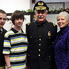 Police Chief Kevin Coppinger poses with wife Beth and sons Sean, left, and Kevin during his swearing in ceremony in Lynn's City Clerk office Thursday December 31, 2009. Item Photo/ Reba M. Saldanha