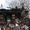 The house at 29 Oakwood Ave. in Lynn, scene of a fire on January 5, is being torn down on Saturday.