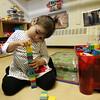 Aaliyah Ramos, 2, plays with blocks at Joi Child Care Monday January 11, 2010. Item Photo/ Reba M. Saldanha