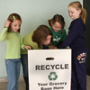 From left to right: Georgia Fiore, Arinna Raftelis, Shaylin Groark, and Makinzie Caron recycle at the Lynnhurst School in Saugus. The school has two of these boxes that collect 200 bags every two weeks.