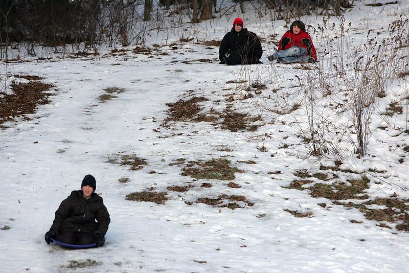 Blake Amborsino sleds as brother Zach, right, and Brian Kinney look on at Frey park in Lynn Tuesday January 12, 2010. Item Photo/Reba M. Saldanha