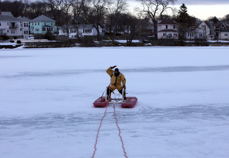Lynn fire fighter Richard Beato demonstrates ice rescue equiptment on Flax Pond Wednesday Januray 13, 2010. Item Photo/ Reba M. Saldanha