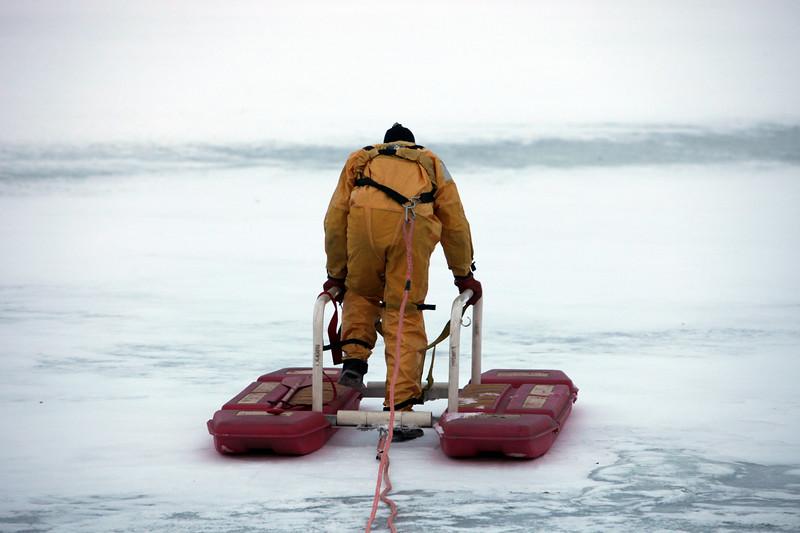 Lynn fire fighter Richard Beato demonstrates ice rescue equiptment on Flax Pond Wednesday Januray 13, 2010. Item Photo/ Reba M. Saldanha