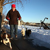 Swampscott dog walker Lucy Shephard takes pups (from left) Max, Tyson, Shelby, and McTavish for a stroll along the waterfront Thursday Janurary 14, 2010. Item Photo/ Reba M. Saldanha