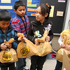The Greater Boston Food Bank distributes weekend food bags to students in Boston and Lawrence. They just added one school in Lynn to the list--the Connery School. Starting this weekend and continuing every other weekend until school gets out in June, First grade and Kindergarten students will get a food bag on Friday--that's a total of 220 bags-- as they leave for the weekend. Members of the student council at the Connery School, Alvin Chhim, 4th grade, Dylan Chau, 5th grade, Amy Colon, 4th grade, and Celian Chau, 4th grade, get ready to distribute weekend food bags to the first grade and kindergarten students at the Connery School.
