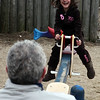 Alan Verrochi rides the see-saw with daughter Gianna, 6,  along Lynn Beach Sunday January 17, 2010. Item Photo/ Reba M. Saldanha