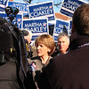 Martha Coakley talking to the press in the parking lot of Brother's Deli on Market Street on Saturday. State Senator Thomas McGee in standing in the background.