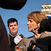 Martha Coakley talks to the press in the parking lot of Brother's Deli in Lynn on Saturday. Rep. Steve Walsh is standing beside her.