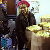 Maria Fowlkes giving out food on Saturday at the Lynn City Mission on Baltimore Street.