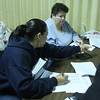 Check in at the Lynn City Mission. Amantina Yina Payano, left, and Kim Wallace. Edner Howard, not in picture.