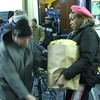 Maria Fowlkes giving out food on Saturday morning  at the Lynn City Mission on Baltimore Street.