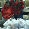 Huddie Hall and Dolorers Gladde in the meat department at the Lynn City Mission on Baltimore Street.