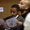 Eugene Schneeberg and his son Eugene Sneeberg JR at the 24th annual Reverend Dr. Martin Luther King, JR holiday observance at North Shore Community College Monday January 18, 2010. Item Photo/ Reba M. Saldanha