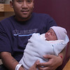 Savann Voeun with his new baby Dillon Kim-Voeun, born at 2:56 am. Weight, 8 pounds 13 ounces. Length: twenty-one and a half inches. Salem Hospital