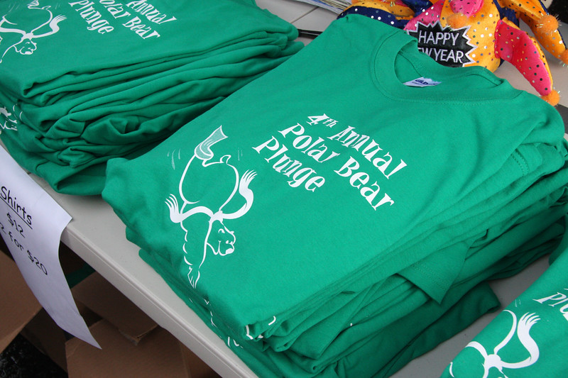 Tee-shirts ware on sale at the 4th annual Polar Bear Plunge at the Swampscott Yacht Club on Friday.