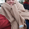 Lauren Murray did not swim in the 4th Polar Bear Plunge at the Swampscott Yacht Club on Friday morning. Her mother Sue did, though. Instead, Lauren held eveybody's coat.