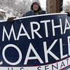 Tom Watkins holding a sign at Briarcliff Lodge in Lynn this morning. He went from this to making phone calls.