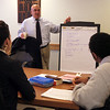 Lynn English High School students Blanca Reyes, left, and Isaak Kifle learn from Peter Colarusso of SCORE in a Lynn Area Chamber of Commerce workshop on creating their own business model at the Chamber in downtown Lynn Thursday January 21, 2010. Item Photo/ Reba M. Saldanha