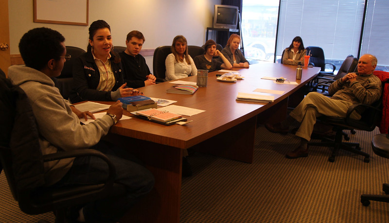 Lynn English High School students (from left) Isakk Kifle, Blanca Reyes, Simone Pilecki, Stephanie Breault, Ryan McKernan, and Samantha Hoy participate in a Lynn Area Chamber of Commerce workshop on creating their own business model with Chamber president Leslie Gould and SCORE counselor Ken Kramer at the Chamber in downtown Lynn Thursday January 21, 2010. Item Photo/ Reba M. Saldanha