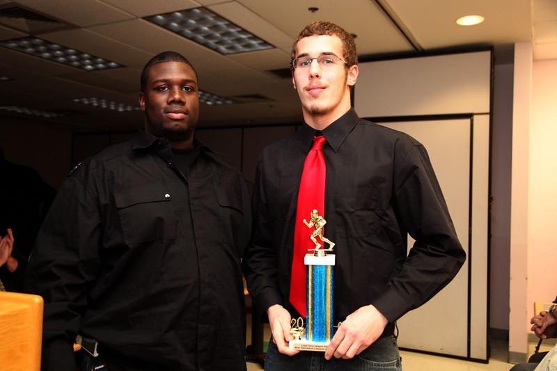 Coach Mackenzie Charles and award winner Alex Quintin at the Tech football banquet Thursday January 21, 2010. Item Photo/ Reba M. Saldanha