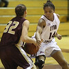Kayla Murkison, 14, tries to steal the ball from Hannah Cain