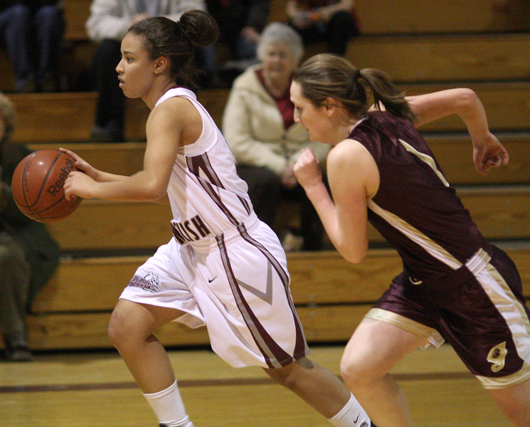 Brianna Vaughan brings the ball down court.