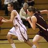 Brianna Vaughan brings the ball down court.