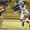 Jenicia Duggins moves the ball down court.