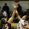 Many Uris, 45, and Olivia Dupree start the game with a jump ball.