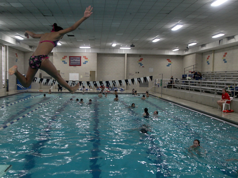 Beri Letts leaps off the diving board during the Parks and Recreation open swim at Lynn Tech pool Sunday January 24, 2010. Item Photo/ Reba M. Saldanha
