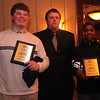 Freshman award winners Josh Dunham, eft, and Brandon Pinnock with coach  at the Classical High School football banquet at Prince House of Pizza Monday January 25, 2010. Item Photo/ Reba M. Saldanha
