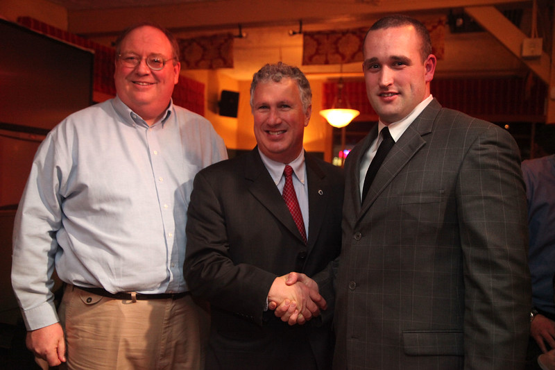 Senator Tom McGee poses with coach Tim Phelps, right, and Keith Bransfield of the booster club at the Classical High School football banquet at Prince House of Pizza Monday January 25, 2010. Item Photo/ Reba M. Saldanha
