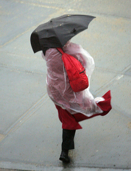 Wind blows on a woman with an umbrella while walking near the Central Square train station in Lynn Monday January 25, 2010. Item Photo/ Reba M. Saldanha
