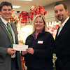 Dan Engberg of Serving People In Need, left, accepts a check for $500 earned during a fundraiser from Stop and Shop florist manager Phyllis Masella and store manager Jack Bartoszewicki